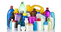Large group of multicolored plastic bottles against white background